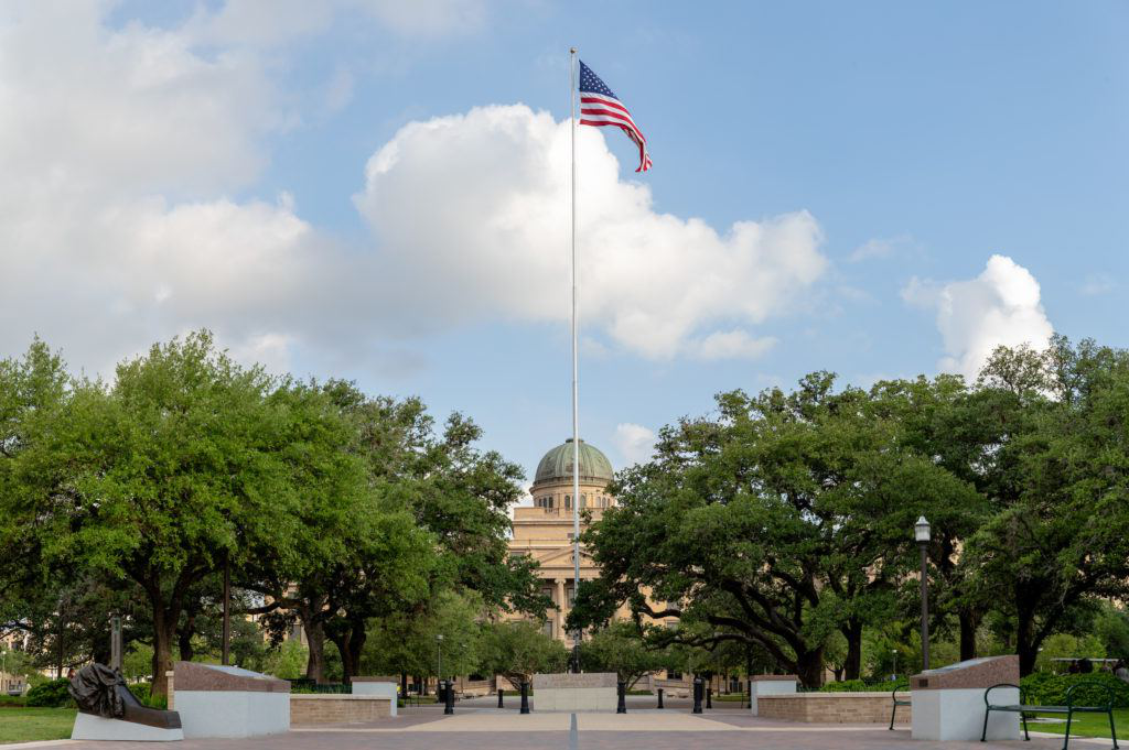 American flag flying in front of the Academic Building
